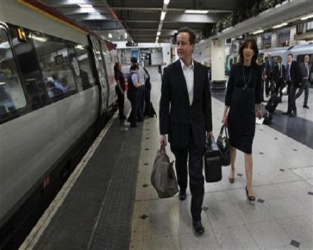 Conservative Party leader Cameron and his wife Samantha arrive at Euston train station in London